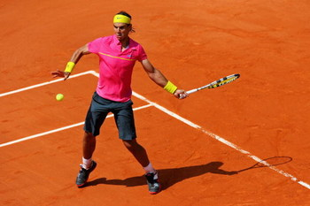 PARIS - MAY 25:  Rafael Nadal of Spain hits a forehand during his Men's Singles First Round match against Marcos Daniel of Brazil at the French Open at Roland Garros on May 25, 2009 in Paris, France.  (Photo by Matthew Stockman/Getty Images)