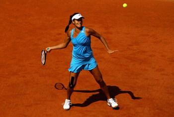 PARIS - MAY 24:  Ana Ivanovic of Serbia hits a forehand during her Ladies' Singles First Round match against Sara Errani of Italy at the French Open on May 24, 2009 in Paris, France.  (Photo by Clive Brunskill/Getty Images)