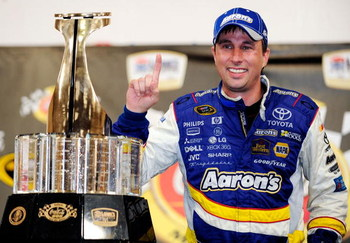 CONCORD, NC - MAY 25:  David Reutimann, driver of the #00 Aaron's Dream Machine Toyota, poses in victory lane after winning the NASCAR Sprint Cup Series Coca-Cola 600 on May 25, 2009 at Lowe's Motor Speedway in Concord, North Carolina. Reutimann won the C