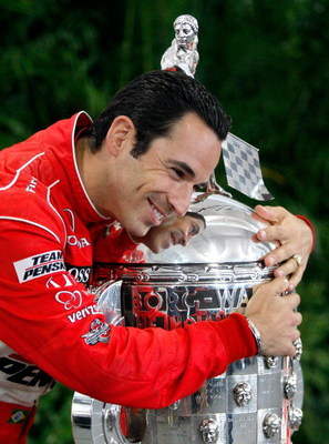 INDIANAPOLIS - MAY 25:  Helio Castroneves, driver of the #3 Team Penske Dallara Honda, poses with the Borg Warner Trophy following his victory in the 93rd Indianapolis 500 on May 25, 2009 at the Indianapolis Motor Speedway in Indianapolis, Indiana.  (Phot