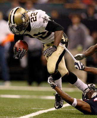 NEW ORLEANS - AUGUST 16:  Tracy Porter #22 of the New Orleans Saints breaks a tackle while taking on the Houston Texans during a pre-season game at Louisiana Superdome on August 16, 2008 in New Orleans Louisiana.  (Photo by Doug Benc/Getty Images)