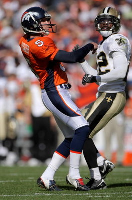 DENVER - SEPTEMBER 21:  Place kicker Matt Prater #5 of the Denver Broncos and Tracy Porter #22 of the New Orleans Saints watch Parter's field goal during NFL action at Invesco Field at Mile High on September 21, 2008 in Denver, Colorado. The Broncos defea