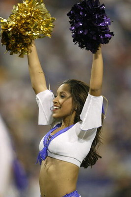 MINNEAPOLIS - SEPTEMBER 26: A cheerleader of the Minnesota Vikings during the game against the Chicago Bears at the Hubert H. Humphrey Metrodome on September 26, 2004 in Minneapolis, Minnesota. The Vikings defeated the Bears 27-22. (Photo by Jeff Gross/Ge