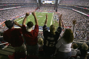 GLENDALE, AZ - FEBRUARY 03:  Fans cheer on the New England Patriots against the New York Giants during Super Bowl XLII on February 3, 2008 at the University of Phoenix Stadium in Glendale, Arizona. The Giants defeated the Patriots 17-14. (Photo by Doug Pe