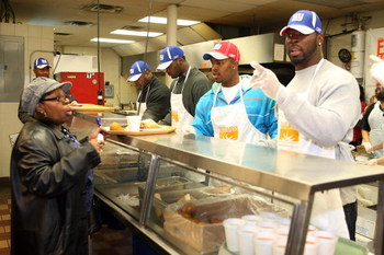 NEW YORK - NOVEMBER 25:  Jeremy Clark, Mathias Kiwanuka, Jerome McDougle, and Justin Tuck of the New York Giants help serve turkeys and fixings to the Community Kitchen of West Harlem on November 25, 2008 in New York City.  (Photo by Scott Gries/Getty Ima