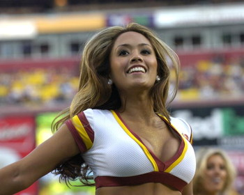 A cheerleader entertains as the Washington Redskins host  the Carolina Panthers  Nov. 26, 2006 at FedEx Field in Washington.  The Skins won 17 - 13.  (Photo by Al Messerschmidt/Getty Images)