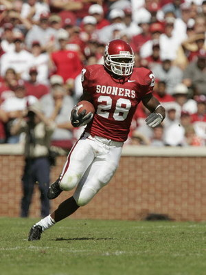 NORMAN, OK - OCTOBER 2:  Running back Adrian Peterson #28 of the Oklahoma Sooners runs upfield against the Texas Tech Red Raiders on October 2, 2004 at Memorial Stadium in Norman, Oklahoma.  The Sooners defeated the Red Raiders  28-13.  (Photo by Brian Ba