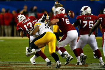TAMPA, FL - FEBRUARY 01:  Quarterback Kurt Warner #13 of the Arizona Cardinals fumbles the ball with :15 seconds to play as he is sacked by LaMarr Woodley #56 of the Pittsburgh Steelers during Super Bowl XLIII on February 1, 2009 at Raymond James Stadium