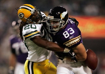 MINNEAPOLIS, MN - SEPTEMBER 30:  Atari Bigby #20 of the Green Bay Packers strips the ball from Jeff Dugan #83 of the Minnesota Vikings resulting in a fumble in the first quarter at the Metrodome on September 30, 2007 in Minneapolis, Minnesota.  (Photo by