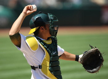 OAKLAND, CA - MAY 07:  Kurt Suzuki #8 of the Oakland Athletics catches against the Texas Rangers during a Major League Baseball game on May 7, 2009 at the Oakland Coliseum in Oakland, California.  (Photo by Jed Jacobsohn/Getty Images)