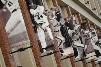 NEW YORK - APRIL 13: Banners of former New York Mets players hang on the outside of Citi Field before opening day on April 13, 2009 in the Flushing neighborhood of the Queens borough of New York City. This is the first regular season MLB game being played