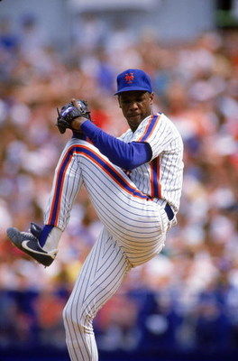 FLUSHING, NY - AUGUST:  Dwight Gooden #16 of the New York Mets pitches during an August 1988 game at Shea Stadium in Flushing, New York.  (Photo by Mike Powell/Getty Images)