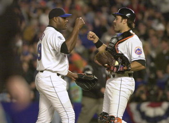 24 Oct 2000:  Catcher #31 Mike Piazza and #49Armando Benitez of the New York Mets celebrate the final out against the New York Yankees during Game 3 of the MLB World Series at Shea Stadium in Flushing, New York. <DIGITAL IMAGE> Mandatory Credit: Ezra Shaw
