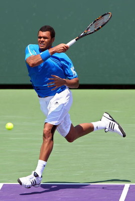 KEY BISCAYNE, FL - MARCH 31:  Jo-Wilfried Tsonga of France returns a shot against Gilles Simon of France during day nine of the Sony Ericsson Open at the Crandon Park Tennis Center on March 31, 2009 in Key Biscayne, Florida.  (Photo by Clive Brunskill/Get