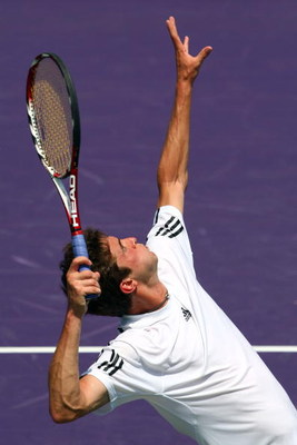 KEY BISCAYNE, FL - MARCH 31:  Gilles Simon of France serves against Jo-Wilfried Tsonga of France during day nine of the Sony Ericsson Open at the Crandon Park Tennis Center on March 31, 2009 in Key Biscayne, Florida.  (Photo by Clive Brunskill/Getty Image