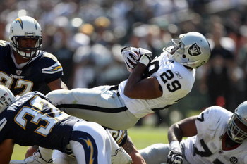 OAKLAND, CA - SEPTEMBER 28:  Michael Bush #29 of the Oakland Raiders dives for yardage during the game against the San Diego Chargers on September 28, 2008 at Oakland Coliseum in Oakland, California. (Photo by Jed Jacobsohn/Getty Images)