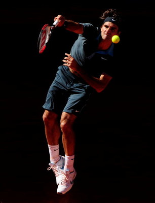 MADRID, SPAIN - MAY 17:  Roger Federer of Switzerland serves the ball to Rafael Nadal of Spain during the final of the Madrid Open tennis tournament at the Caja Magica on May 17, 2009 in Madrid, Spain. Federer won the match in two sets, 6-4 and 6-4.  (Pho
