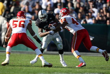 OAKLAND, CA - NOVEMBER 30: Darren McFadden #20 of the Oakland Raiders runs against Derrick Johnson #56 and Jarrad Page #44 of the Kansas City Chiefs during an NFL game on November 30, 2008 at the Oakland-Alameda County Coliseum in Oakland, California. (Ph