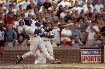12 Sep 1998:  Sammy Sosa #21 of the Chicago Cubs hits his 60th home run during the game against the Milwaukee Brewers at Wrigley Field in Chicago, Illinois. The Cubs defeated the Brewers 15-12. Mandatory Credit: Tim Brokema  /Allsport