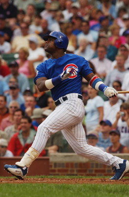 CHICAGO - JULY 16:  Sammy Sosa #21 of the Chicago Cubs bats during a game against the Milwaukee Brewers on July 16, 2004 at Wrigley Field in Chicago, Illinois.  The Brewers defeated the Cubs 3-2.  (Photo by Jonathan Daniel/Getty Images)