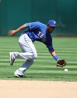 OAKLAND, CA - MAY 07:  Elvis Andrus #1 of the Texas Rangers fields a ball against the Oakland Athletics during a Major League Baseball game on May 7, 2009 at the Oakland Coliseum in Oakland, California.  (Photo by Jed Jacobsohn/Getty Images)