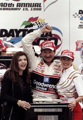 DAYTONA BEACH - FEBRUARY 15:  Dale Earnhardt Sr. driver of the #3 GM Goodwrench Chevrolet and wife Teresa celebrate victory with the trophy after the Nascar Daytona 500 on February 15, 1998 at the Daytona International Speedway in Daytona Beach, Florida.