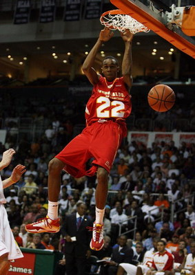 CORAL GABLES, FL - APRIL 01:  John Henson #22 of the West Team dunks against the East Team in the 2009 McDonald's All American Men's High School Basketball Game at BankUnited Center on April 1, 2009 in Coral Gables, Florida.  (Photo by Doug Benc/Getty Ima