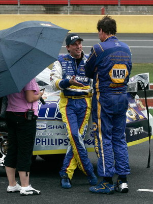 CONCORD, NC - MAY 25:  David Reutimann (C), driver of the #00 Aaron's Dream Machine Toyota, talks with Michael Waltrip (R), driver of the #55 NAPA Auto Parts Toyota, during the NASCAR Sprint Cup Series Coca-Cola 600 on May 25, 2009 at Lowe's Motor Speedwa