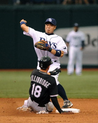 ST. PETERSBURG, FL - APRIL 19: Infielder Akinori Iwamura #1 of the Tampa Bay Rays throws to first base for a double play against the Chicago White Sox April 19, 2009 at Tropicana Field in St. Petersburg, Florida.  (Photo by Al Messerschmidt/Getty Images)