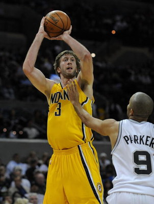 SAN ANTONIO - JANUARY 20:  Forward Troy Murphy #3 of the Indiana Pacers takes a shot against Tony Parker #9 of the San Antonio Spurs on January 20, 2009 at AT&T Center in San Antonio, Texas.  NOTE TO USER: User expressly acknowledges and agrees that, by d
