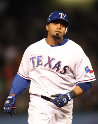ARLINGTON, TX - APRIL 15:  Nelson Cruz of the Texas Rangers runs after hitting a grandslam while wearing jersey #42 to commemorate Jackie Robinson day during a game against the Baltimore Orioles on April 15, 2009 at Rangers Ballpark in Arlington, Texas.  