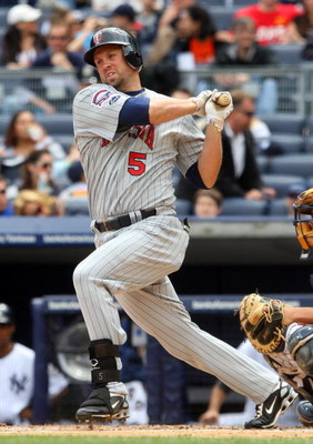 NEW YORK - MAY 17:  Michael Cuddyer #5 of the Minnesota Twins bats against the New York Yankees on May 17, 2009 at Yankee Stadium in the Bronx borough of New York City. The Yankees defeated the Twins 3-2 in ten innings.  (Photo by Jim McIsaac/Getty Images