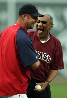 BOSTON - AUGUST 14:  Tim Wakefield #49 of the Boston Red Sox jokes with comedian Bill Cosby after Cosby threw out the first pitch before the game against the Texas Rangers on August 14, 2008 at Fenway Park in Boston, Massachusetts.  (Photo by Elsa/Getty I