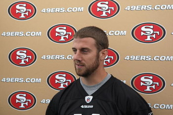 SANTA CLARA, CA - MAY 01:  Quarterback Alex Smith #11 of the San Francisco 49ers talks with the media during the 49ers Minicamp at their training facilities on May 1, 2009 in Santa Clara, California.  (Photo by Jed Jacobsohn/Getty Images)