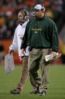 DENVER - OCTOBER 29:  Head coach Mike McCarthy (R) of the Green Bay Packers and defensive coordinator Bob Sanders (L) direct the team against the Denver Broncos at Invesco Field at Mile High on October 29, 2007 in Denver, Colorado. The Packers defeated th