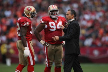 SAN FRANCISCO - NOVEMBER 18:  Head coach Mike Nolan of the San Francisco 49ers talks with Patrick Willis #52 and Marques Douglas #94 during the game against the St. Louis Rams on November 18, 2007 at Monster Park in San Francisco, California. (Photo by Je