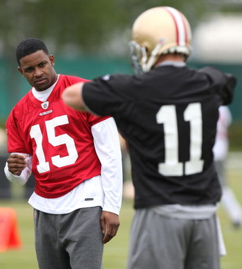 SANTA CLARA, CA - MAY 01:  Michael Crabtree #15 of the San Francisco 49ers looks on during practice as quaterback Alex Smith #11 practices during the 49ers Minicamp at their training facilities on May 1, 2009 in Santa Clara, California. Crabtree was the 4