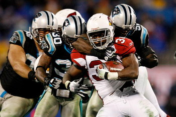 CHARLOTTE, NC - JANUARY 10:  Edgerrin James #32 of the Arizona Cardinals pushes through for a first down against the Carolina Panthers during the NFC Divisional Playoff Game on January 10, 2009 at Bank of America Stadium in Charlotte, North Carolina.  (Ph