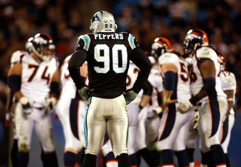 CHARLOTTE, NC - DECEMBER 14:  Julius Peppers #90 of the Carolina Panthers waits for the Denver Broncos offense during their game at Bank of America Stadium on December 14, 2008 in Charlotte, North Carolina  (Photo by Streeter Lecka/Getty Images)