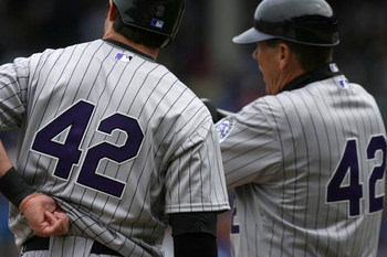 CHICAGO - APRIL 15: Ian Stewart (L) and third base coach Rich Dauer of the Colorado Rockies wear #42 jerseys in honor of Jackie Robinson Day during a game against the Chicago Cubs on April 15, 2009 at Wrigley Field in Chicago, Illinois. (Photo by Jonathan