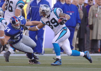 Steve Smith of the Carolina Panthers runs past Nick Greisen during the NFC Wild Card playoff game between the New York Giants and Carolina Panthers at Giants Stadium in East Rutherford, New Jersey on January 8, 2006.  (Photo by Al Messerschmidt/Getty Imag