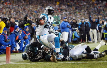 PHILADELPHIA - JANUARY 18:  Running back DeShaun Foster #20 of the Carolina Panthers scores a touchdown on a 1-yard run against the Philadelphia Eagles in the third quarter during the NFC Championship game on January 18, 2004 at Lincoln Financial Field in