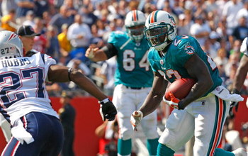 FOXBORO, MA - SEPTEMBER 21: Ronnie Brown #23 of the Miami Dolphins runs for yardage against the New England Patriots at Gillette Stadium on September 21, 2008 in Foxboro, Massachusetts. The Dolphins won 38-13. (Photo by Jim Rogash/Getty Images)