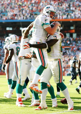 MIAMI - NOVEMBER 09:  Running back Ronnie Brown #23 and quarterback Chad Pennington #10 of the Miami Dolphins celebrate after Brown's touchdown run in the fourth quarter against the Seattle Seahawks at Dolphin Stadium on November 9, 2008 in Miami, Florida