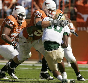 AUSTIN, TX - NOVEMBER 8:  Defensive tackle Roy Miller #99 of the Texas Longhorns sacks quarterback Robert Griffin #10 of the Baylor Bears in the second quarter on November 8, 2008 at Darrell K Royal-Texas Memorial Stadium in Austin, Texas.  (Photo by Bria