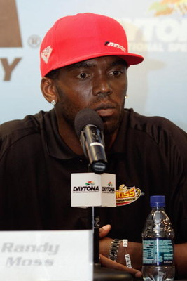 DAYTONA BEACH, FL - JULY 03:  NFL player Randy Moss of the New England Patriots speaks to the media during a press conference prior to the start of practice for the NASCAR Sprint Cup Series Coke Zero 400 at Daytona International Speedway on July 3, 2008 i