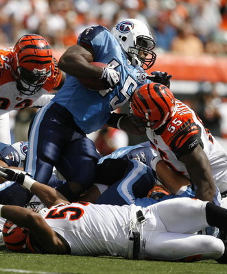 CINCINNATI - SEPTEMBER 14:  Ahmard Hall #45 of the Tennessee Titans is hit by Keith Rivers #55 of the Cincinnati Bengals during the first quarter of their NFL game September 14, 2008 at Paul Brown Stadium in Cincinnati, Ohio. The Titans defeated the Benga