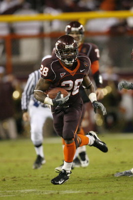 BLACKSBURG ? OCTOBER 25:  Michael Dell'Aquila #28 of the Virginia Tech Hokies carries the ball during the game against the Boston College Eagles at Lane Stadium on October 25, 2007 in Blacksburg, Virginia. (Photo by Kevin C. Cox/Getty Images)