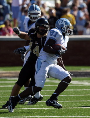 WINSTON SALEM, NC - OCTOBER 27:  Mike Rinfrette #44 the Linebacker of Wake Forest Demon Deacons tackles Brandon Tate #87 of the UNC Tar Heels during the ACC game at the Groves Stadium, on October 27, 2007 in Winston Salem,North Carolina.  (Photo by David