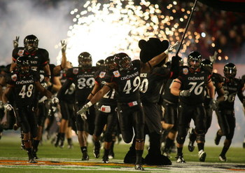 MIAMI - JANUARY 01: The Cincinnati Bearcats take the field prior start the FedEx Orange Bowl against the  Virginia Tech Hokies at Dolphin Stadium on January 1, 2009 in Miami, Florida.  (Photo by Marc Serota/Getty Images)